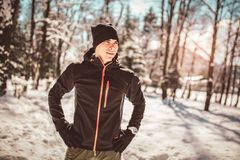 Man Taking Break From Running in Extreme Snow Conditions. Man Sportsman Taking Break From Running in Extreme Snow Conditions Stock Image