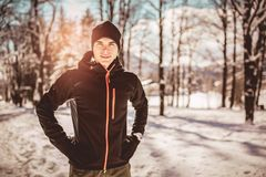 Man Taking Break From Running in Extreme Snow Conditions. Man Sportsman Taking Break From Running in Extreme Snow Conditions Royalty Free Stock Photos
