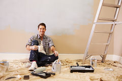 Man Taking A Break Whilst Decorating Room Royalty Free Stock Image