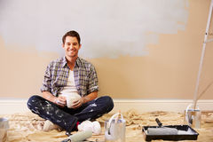 Man Taking A Break Whilst Decorating Room Royalty Free Stock Images