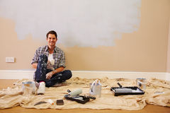Man Taking A Break Whilst Decorating Room Royalty Free Stock Photo