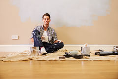 Man Taking A Break Whilst Decorating Room Stock Image