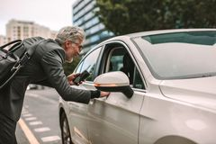 Man taking cab for traveling Stock Photography