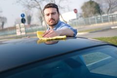 Man taking care and cleaning his car Royalty Free Stock Images