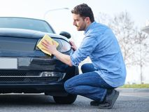 Man taking care and cleaning his car Stock Photos