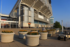 Man taking care of flowers. In front of the Cleveland Browns stadium stock photography