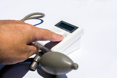 Man is taking care for health with hearth beat monitor and blood pressure Stock Images