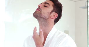 Man taking care of his face in the morning