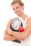 Man taking care of his weight Stock Photos
