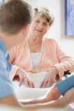Man taking care of older woman Royalty Free Stock Photography
