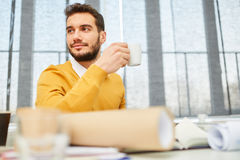 Man taking a coffee break Royalty Free Stock Image