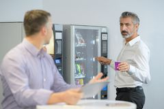 Man taking coffee from vending machine. Coffee stock photo
