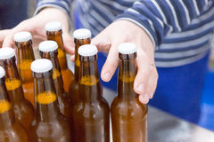 Man taking craft beer bottles Royalty Free Stock Images
