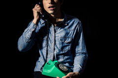 Man taking disturbing phone call Stock Photo
