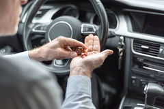 Man taking drugs before driving. His car Royalty Free Stock Images