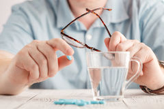 Man taking drugs. Drugs on hand. Stock Photography