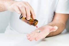 Man taking drugs Stock Images