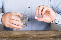 Man taking drugs Stock Photo