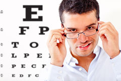 Man taking an eye exam Stock Photo