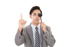 Man taking an eye test. Asian man with eye paddle royalty free stock photos