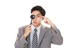 Man taking an eye test. Asian man with an eye paddle stock photo
