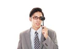 Man taking an eye test. Asian man with eye paddle royalty free stock image