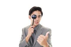 Man taking an eye test. Asian man with eye paddle royalty free stock photo