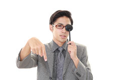Man taking an eye test. Asian man with eye paddle stock photo