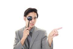 Man taking an eye test. Asian man with eye paddle stock photos