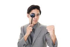 Man taking an eye test. Asian man with eye paddle stock images