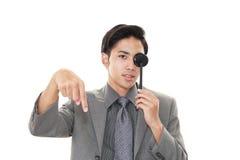 Man taking an eye test. Asian man with eye paddle stock image