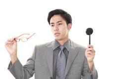 Man taking an eye test. Asian man with eye paddle stock photography