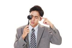 Man taking an eye test. Asian man with an eye paddle stock photography