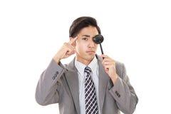 Man taking an eye test. Asian man with an eye paddle stock photos