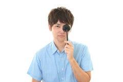 Man taking an eye test. Man covers left eye with eye paddle royalty free stock photos