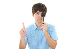 Man taking an eye test. Man covers left eye with eye paddle stock images