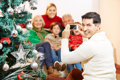 Man taking family picture at christmas Stock Images