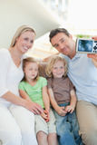 Man taking family picture on sofa Royalty Free Stock Images