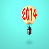 Man taking glowing lamp balloon with 2014 word on it. Looking at distant place, in green background royalty free illustration