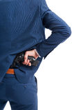 Man taking a gun from his back. In close-up view as secret agent concept isolated on white Royalty Free Stock Images