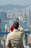 Man taking his friend photo Stock Images