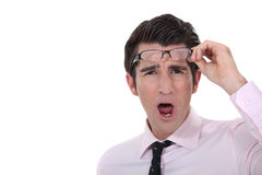 Man taking his glasses off. In dismay royalty free stock image