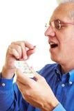 Man taking his medication Royalty Free Stock Photo