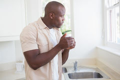 A man taking his tea and looking outside Royalty Free Stock Image