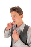 Man taking his tie of. Stock Photography