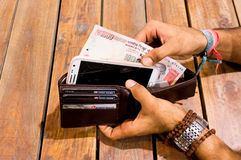 Man taking indian payment options out of a wallet Stock Photos