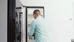 Man taking juice from fridge at home kitchen stock footage