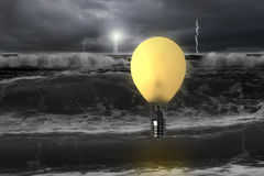 Man taking lamp balloon with dramatic ocean, lightning and light. Man taking glowing lamp balloon with dramatic ocean, lightning and lighthouse , dangerous Stock Images