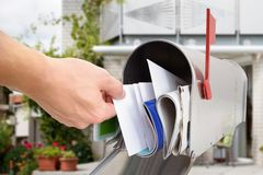 Man taking letter from mailbox Royalty Free Stock Photography