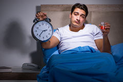 The man taking medical pills from insomnia Stock Photos
